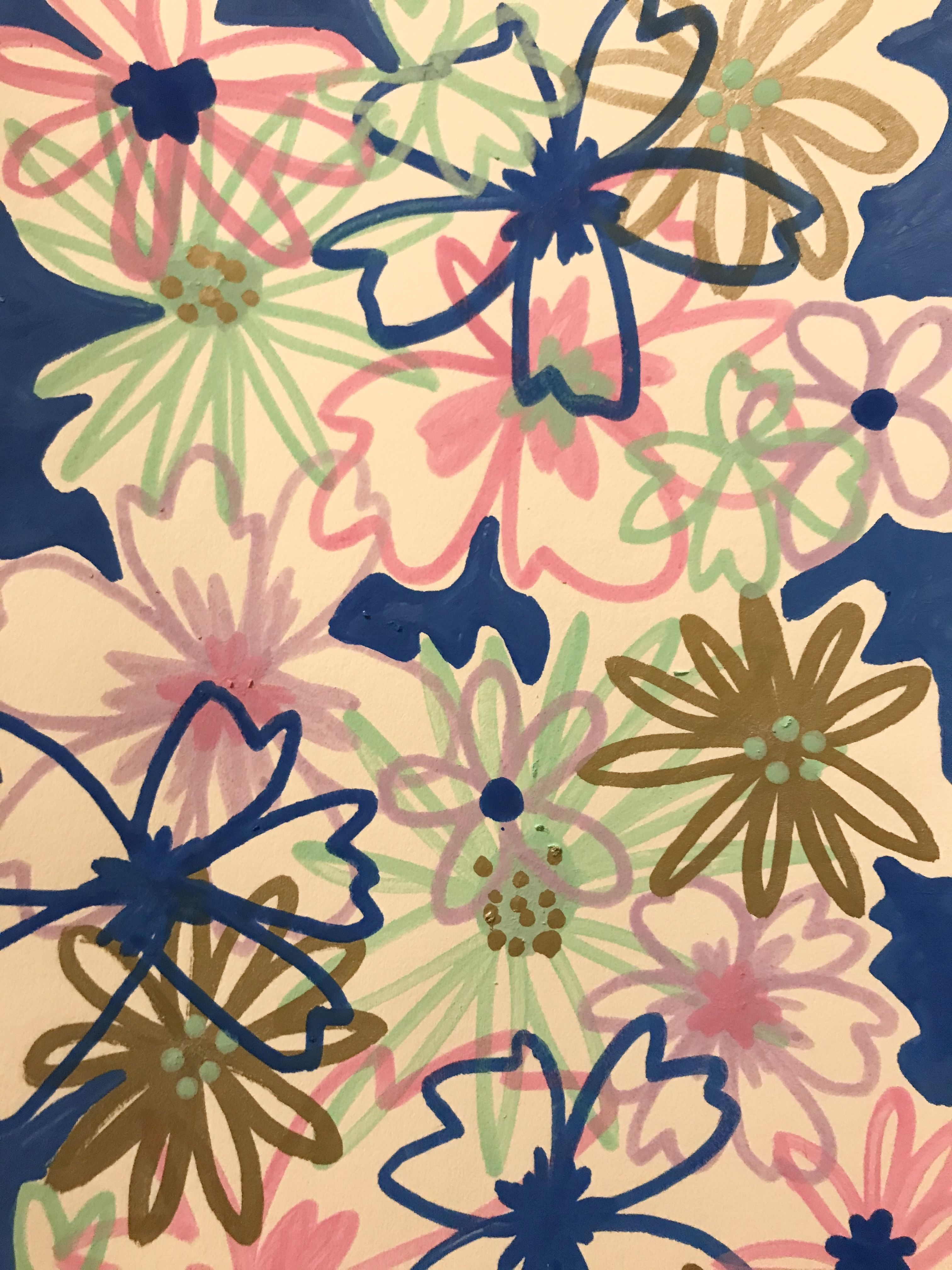 Collage of flowers made with paint markers on watercolor paper