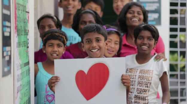 NGO, reaching hand, Justin Bieber, music video, beatboxing