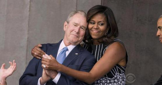 Michelle Obama hugs George Bush at the opening of the National Museum of African American History and Culture.