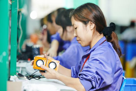 Stock image of assembly worker. Use license purchased from Bigstock.com.